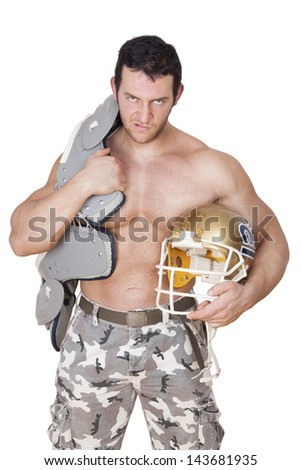 Big shirtless sexy football player with protection and helmet angry looking into the camera isolated on white background. Sport and Fitness concept.