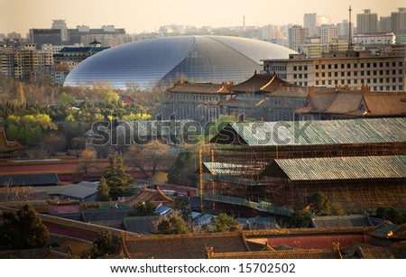 Big Silver Egg Concert Hall Close Up Beijing China Forbidden City in Foreground Trademarks removed.