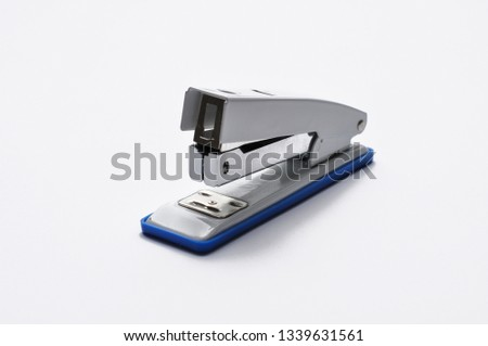 Big silver stapler is isolated on a white background