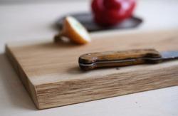 big size solid oak cutting board with dark bred on it