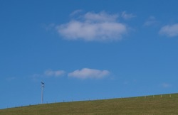 Big sky and horizon with fence and telegraph pole. Sunny day, UK.
