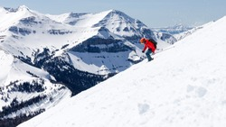 Big Sky Montana side country skier with Rocky on the background.