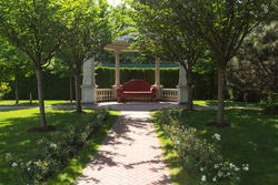 Big sofa in a arbor in the garden ang footpath.Mezhyhirya is the main landmark of Ukrainian corruption. Beautiful place with large gardens and wonderful arbors and footpaths