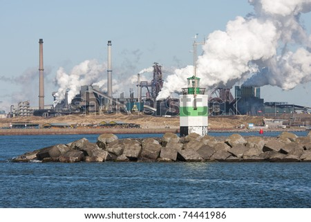 Big steel factory with harbor at the Dutch coast
