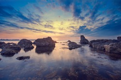 Big stones, sea and unusually sunset. The natural landscape