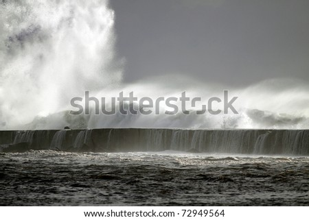 Big storm wave against harbor of Vila do Conde, north of Portugal