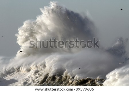 Big stormy wave against lighthouse in the north of Portugal near mouth of river Douro in Porto