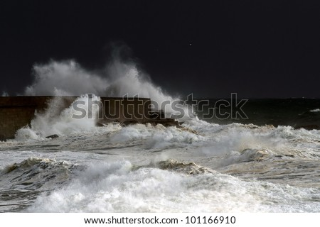 Big stormy waves crashing over Portuguese Coast - north wall of Leixoes harbor - stock photo