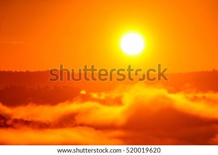 Big sun and Mist in sunrise,Morning,White balance orange on sunrise - Shutterstock ID 520019620