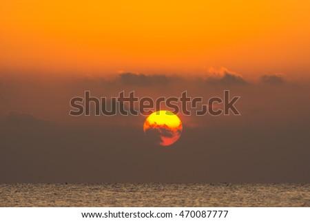big sun in morning over the sea #470087777