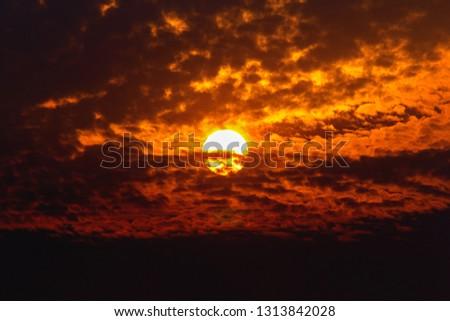 Big sun on dark cloud #1313842028