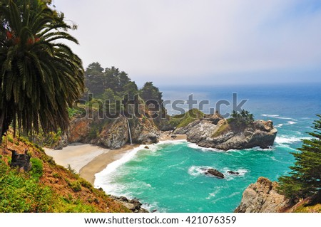 Big Sur, California: view of McWay Falls on June 12, 2010. McWay Falls is an 80-foot waterfall that flows directly into the Pacific ocean in Julia Pfeiffer Burns State Park #421076359