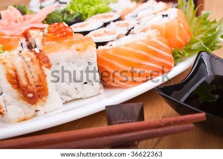 big sushi set with chopsticks and soy sauce close-up - stock photo