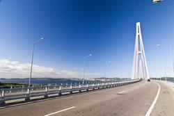 Big suspension bridge in Vladivostok in beams of a bright sun