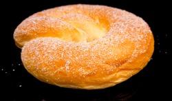 Big sweet Sugar Pretzel - close up shot food photography