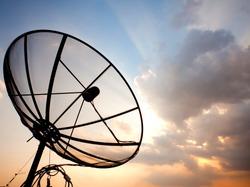 Big telecommunication satellite dish over sunset sky