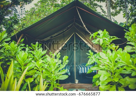 Big tent hidden in the jungle. Adventure holidays.