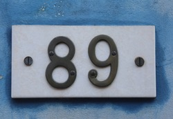 Big Text with number 89 on the wall of an house