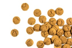 Big Throw of scattered pepernoten cookies  from above on white background for annual Sinterklaas holiday event in the Netherlands on december 5th