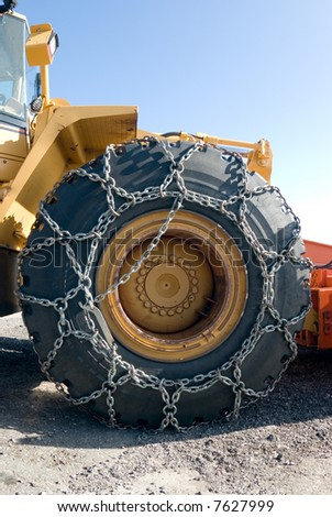 Big tire of snowplow with the chain for snow and icy
