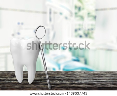 Big tooth and dentist mirror, medical concept #1439037743
