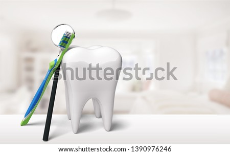 Big tooth model and toothbrush on background #1390976246