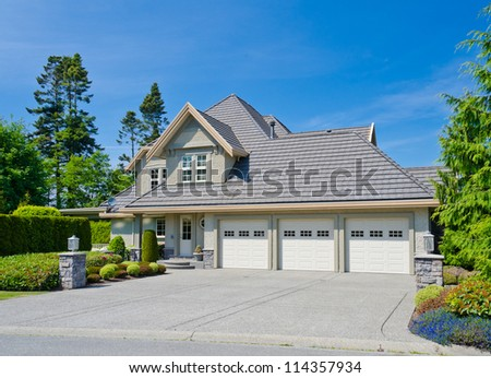 Big, triple garage doors, custom made luxury house in the suburbs of Vancouver, Canada.