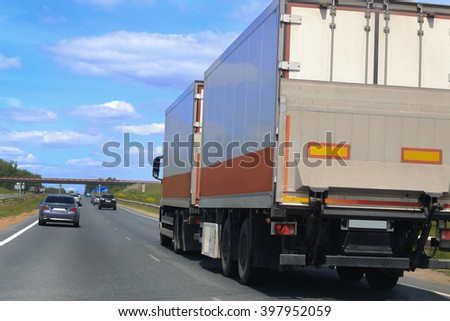 big truck with the trailer moves on the highway #397952059