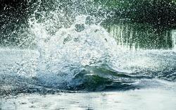 big water splash in lake after diving. Splash water on the river, beautiful colorful, bright splash