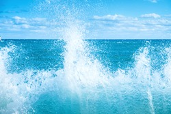 Big wave on the blue sea. Surf and foam