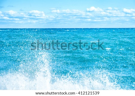 Big wave on the blue sea. Surf and foam #412121539