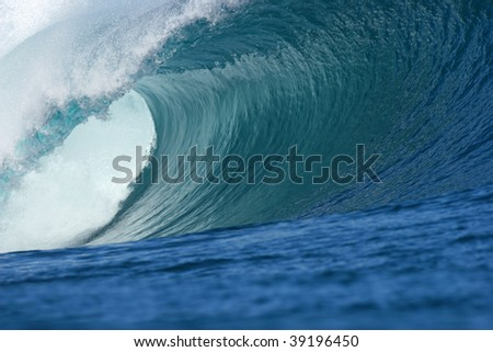 big wave producing a big barrel with beautiful texture and amazing colors