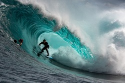 Big wave surfer in a perfect barrel at Shipstern Bluff, Tasmania