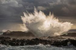 big wave swash the reef before storm