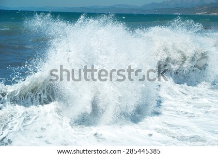 Big wave with sea foam and blue water