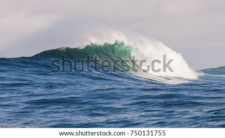 Big waves breaking on an reef along the coast of South Africa #750131755