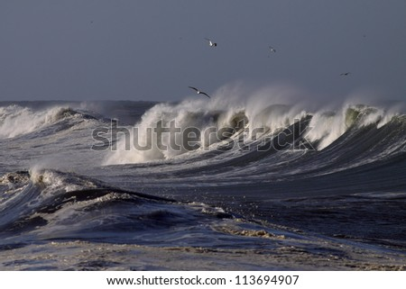 Big waves on the Portuguese coast in a sunny but stormy autumn morning