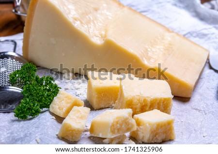 Big wedge of parmigiano-reggiano parmesan hard Italian cheese made from cow milk or Grana Padano  close up Foto d'archivio ©