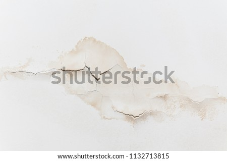 Big wet spots and cracks on the ceiling of the domestic house room after heavy rain and lot of water Stok fotoğraf ©