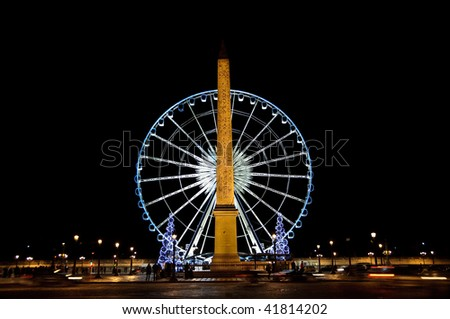 Big wheel and obelisk on Concorde square, in Paris (France)