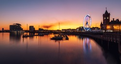 Big Wheel, Pier head building and ferris building located in Mermaid Quay of Cardiff Bay - Cardiff, Wales, United Kingdom at Night