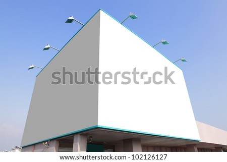 big white blank billboard with blue sky background, empty area in image is great for designer