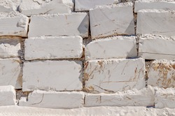 Big white blocks of raw marble in a quarry in Greece