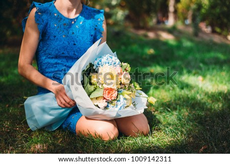 Big white bouquet of a girl, the girl is sitting on the grass #1009142311