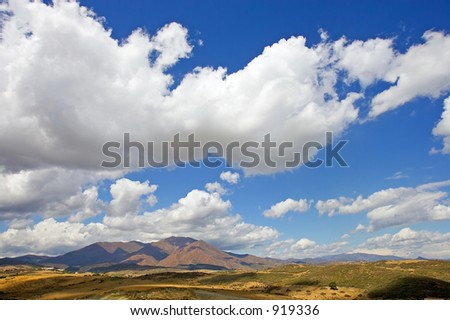Big white fluffy clouds over mountains in Estepona on the Costa del Sol in Spain - stock photo