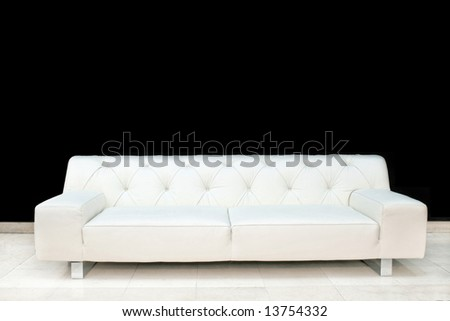Big white leather sofa in empty space
