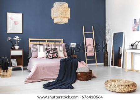 Big white mirror standing in the corner of cozy bedroom #676410664