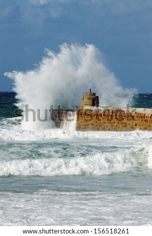 Big white water wave splash, Portreath pier, Cornwall England.