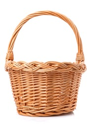 Big wicker basket on a white background. The basket is made of vines. Handmade.