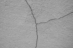 Big winding ascending crack on an old concrete wall. Square divided into three parts. Concrete background. Close-up. Selective focus. Copy space.